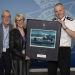 A memorial image has been presented to the family of a former GMP police officer who died on duty in Canada.